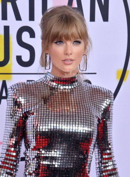 Taylor Swift arrives for the 46th annual American Music Awards on Tuesday. Photo by Jim Ruymen/UPI