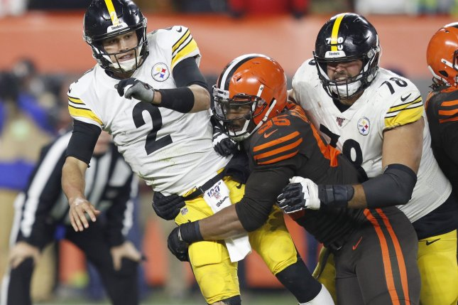 Cleveland Browns defensive end Myles Garrett (95) was suspended for the final six games last season after hitting Pittsburgh Steelers quarterback Mason Rudolph (2) with his own helmet during a skirmish at the end of their Nov. 14 game. The NFL reinstated Garrett earlier this off-season. File Photo by Aaron Josefczyk/UPI
