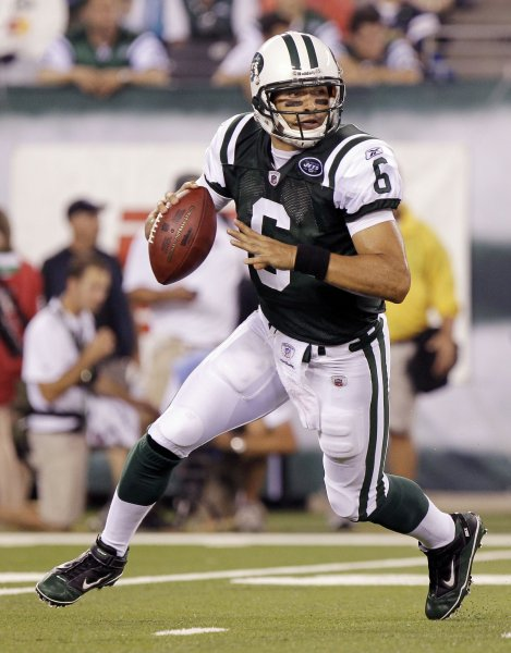 New York Jets Mark Sanchez rolls out of the pocket in the first quarter against the New York Giants in week 1 of the NFL Preseason at the New Meadowlands Stadium in East Rutherford, New Jersey on August 16, 2010. UPI /John Angelillo