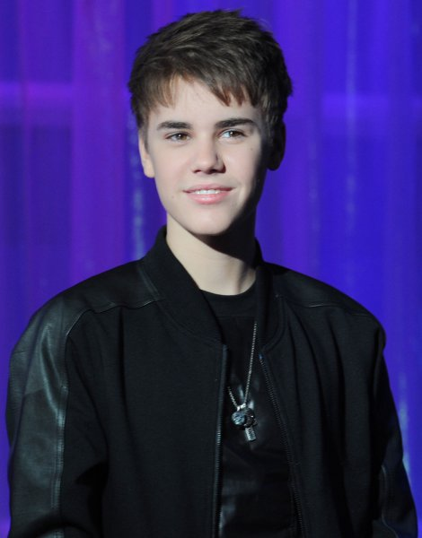 Canadian singer Justin Bieber attends the unveiling of his new waxwork at Madame Tussauds in London on March 15, 2011. UPI/Rune Hellestad