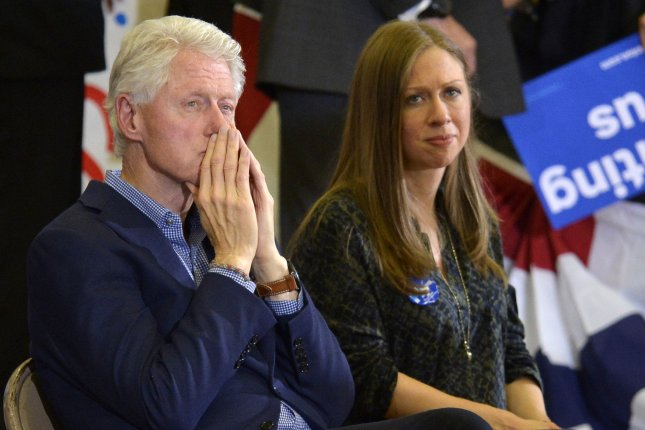 Chelsea Clinton (R), daughter of former President Bill Clinton (L), mistakenly called Sen. Bernie Sanders President Sanders while campaigning for her mother, former Secretary of State Hillary Clinton, in Minnesota on Thursday. Photo by Mike Theiler/UPI