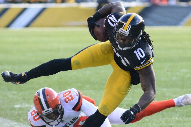 Former Pittsburgh Steelers wide receiver Martavis Bryant (10) gains 14 yards before Cleveland Browns defensive back Briean Boddy-Calhoun (20) makes the tackle in the second quarter against the Cleveland Browns on December 31, 2017 at Heinz Field in Pittsburgh. Photo by Archie Carpenter/UPI
