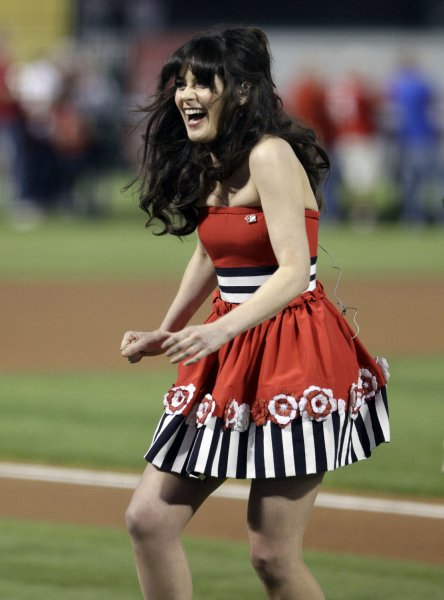 Actress Zooey Deschanel leaves the field after singing the National Anthem prior to Game Four of the 2011 World Series between the St. Louis Cardinals and the Texas Rangers at Rangers Ballpark in Arlington on Sunday, October 23, 2011 in Arlington, Texas. UPI/Tony Gutierrez/Pool/MLB Photos