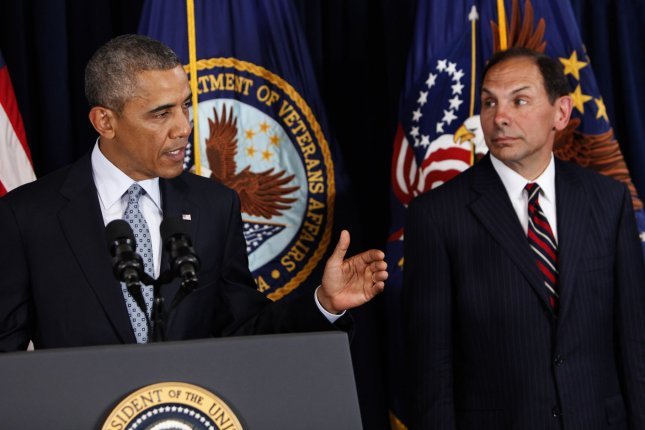 President Barack Obama announces his intention to nominate Robert McDonald (R) to lead the Department of Veterans Affairs in Washington, DC on June 30, 2014. UPI/ Dennis Brack/Pool