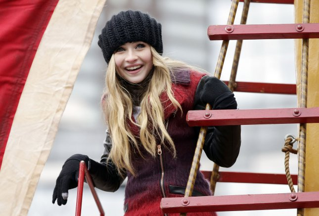 Sabrina Carpenter waves as he rides down the parade route on a float at the 88th Macy's Thanksgiving Day Parade in New York City on November 27, 2014. UPI/John Angelillo