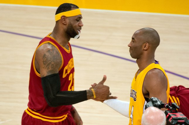 Cleveland Cavaliers forward LeBron James (L) shakes hands with Kobe Bryant prior to the start of their NBA game at Staples Center in Los Angeles, January 15, 2015. James and Bryant played against each other for the final time on March 10, 2016, with the Cavaliers coasting past the Lakers 120-106. File photo Jon SooHoo/UPI