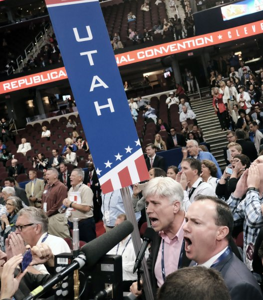 Utah Sen. Mike Lee, right, stands with his party's delegation head Phil Wright, shouting for recognition from the chair at the Republican National Convention inside Quicken Loans Arena in Cleveland on Monday. Lee helped lead a floor fight challenging the party's proposed rules package, which guaranteed a smooth nomination for Donald Trump, and that will govern party business for the next four years. Lee's attempt ended in failure after an acrominous few minutes of shouting form both sides. Photo by Pete Marovich/UPI