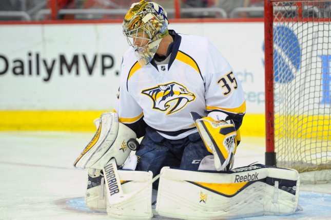 Pekka Rinne stopped 25 shots Monday night as the Nashville Predators warmed up after a sluggish first period for a 3-1 win over the Arizona Coyotes in Bridgestone Arena. File Photo by Mark Goldman/UPI