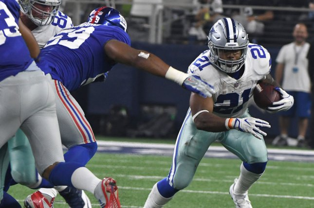 Dallas Cowboys running back Ezekiel Elliot gets outside on a short run against the New York Giants at AT&T Stadium in Arlington, TX on September 10, 2017. Photo by Ian Halperin/UPI