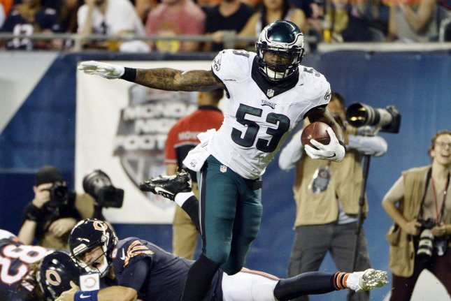 Philadelphia Eagles linebacker Nigel Bradham (R) returns an interception 28 yards as Chicago Bears quarterback Jay Cutler misses a tackle during the third quarter at Soldier Field in Chicago on September 19, 2016. File photo by Brian Kersey/UPI
