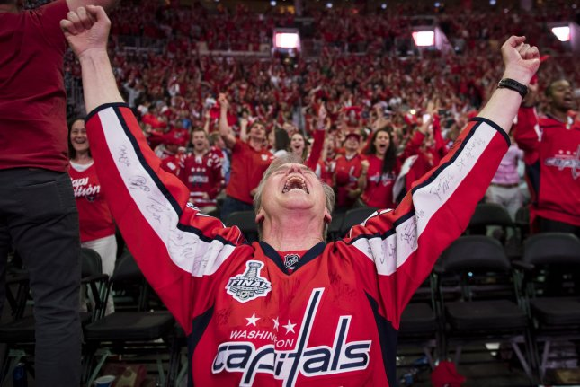 A Washington Capitals fan celebrates as the Capitals win the Stanley Cup, during a watch party Thursday at the Capital One Arena, in Washington, D.C. Photo by Kevin Dietsch/UPI