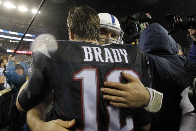2c0955a052e New England Patriots quarterback Tom Brady (12) embraces Indianapolis Colts  quarterback Andrew Luck after the Patriots defeated the Colts 45-7 in the  AFC ...