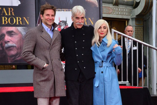 Sam Elliott (C) is joined by Bradley Cooper (L) and Lady Gaga (R) during a hand and footprint ceremony immortalizing him in the forecourt of the TCL Chinese Theatre in Hollywood on January 7. Photo by Jim Ruymen/UPI