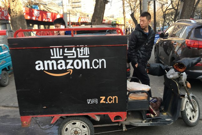 An Amazon China delivery cart is parked on a street in Beijing. On Monday the company announced a goal of making 50 percent of its shipments carbon neutral by 2030. File Photo by Stephen Shaver/UPI