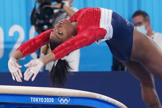 Simone Biles competes on the vault at the women's artistic team all-around finals at the Tokyo 2020 Summer Olympic Games on Tuesday. Biles missed her landing and then pulled out of the team competition after this vault. Photo by Richard Ellis/UPI