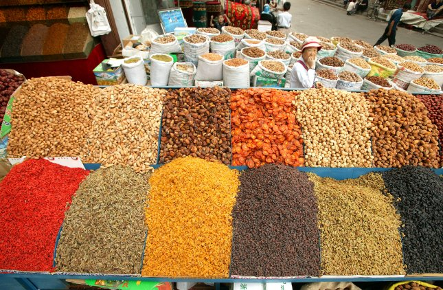 Raisins may lower food intake; help prevent diabetes, heart disease. Nuts and raisins of all colors are displayed for sale in central Urumqi, Xinjiang, China. (UPI Photo/Stephen Shaver)