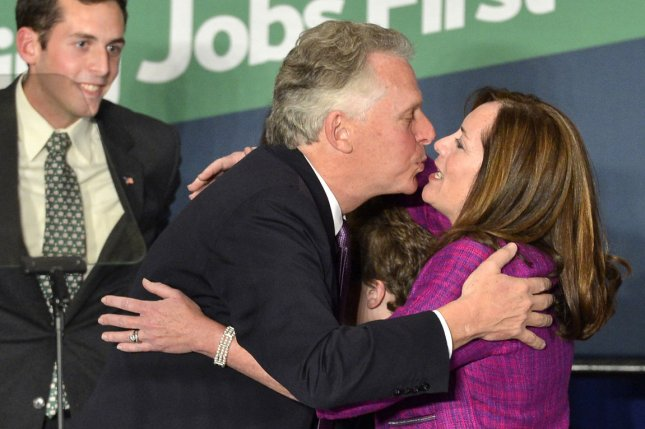 Democrat Terry McAuliffe embraces his wife Dorothy as he claims victory in Virginia's gubernatorial race during a celebration, in Tyson's Corner, Virginia, November 5, 2013. McAuliffe defeated Virginia Attorney General Republican Ken Cuccinelli in a race closely watched by the rest of the country. UPI/Mike Theiler