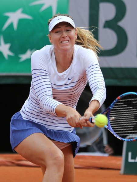 Maria Sharapova of Russia hits a shot during her French Open women's third round match against Australian Samantha Stosur at Roland Garros in Paris on May 29, 2015. Photo by David Silpa/UPI