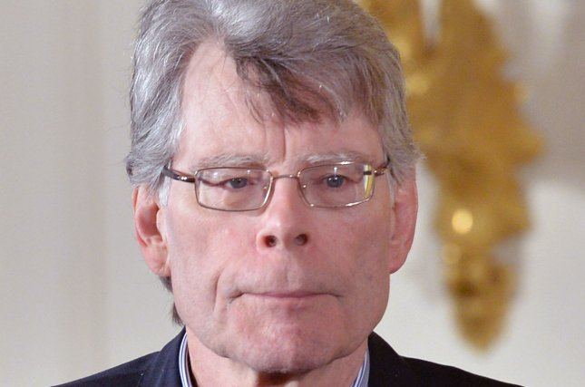 President Barack Obama awards a 2014 National Medal of Arts to author Stephen King during a ceremony at the White House in Washington, D.C. on September 10, 2015. Hulu has ordered 10 episodes of Castle Rock, a thriller series based on King's works. File Photo by Kevin Dietsch/UPI