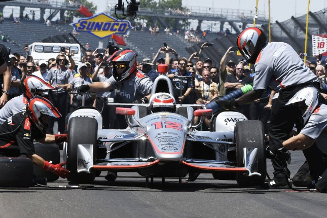 Will Power's crew works on one of the winning pit stops during a pre-race competition at the Indianapolis Motor Speedway on May 26, 2017. File photo by Larry Papke/UPI