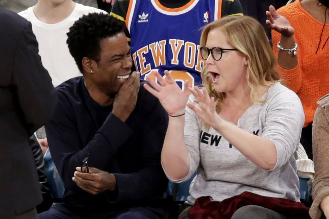 Amy Schumer: I don't 'deserve equal pay' with Chris Rock