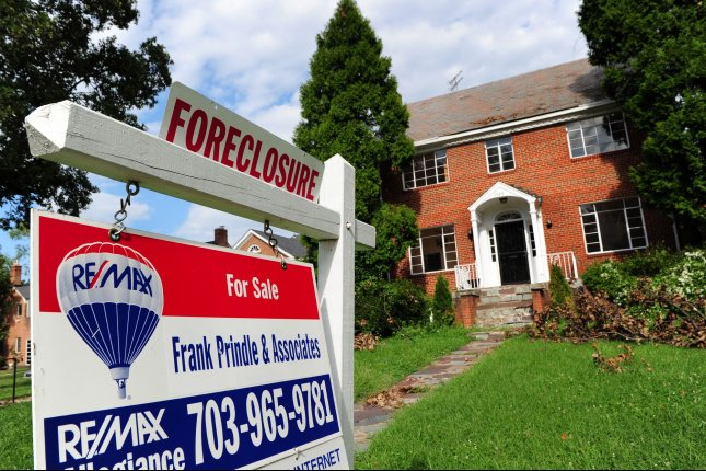 A foreclosed home is seen for sale in northwest Washington, D.C. A crash of the subprime mortgage market in the 2000s was a major contributor to the financial crisis. File Photo by Kevin Dietsch/UPI