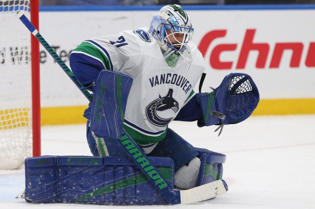 Vancouver Canucks goaltender Anders Nilsson of Sweden, eyes the puck in the first period against the St. Louis Blues at the Scottrade Center in St. Louis on March 23, 2018. Photo by Bill Greenblatt/UPI