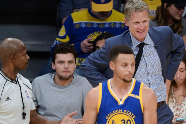 Golden State Warriors point guard Stephen Curry (R) argues a call as head coach Steve Kerr chimes in. File photo by Jim Ruymen/UPI
