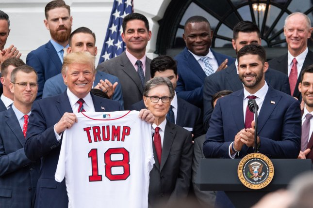 President Donald Trump holds up a commemorative jersey as he welcomes the 2018 World Series Champions Boston Red Sox, during a ceremony honoring them at the White House on Thursday. Photo by Kevin Dietsch/UPI