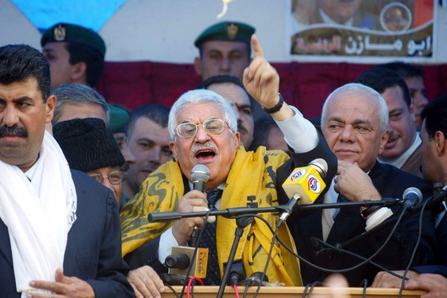 Interim Palestinian leader and presidential front-runner Mahmoud Abbas speaks to supporters during a campaign rally at Khan Younis, southern Gaza Strip on January 4, 2005. He was elected president five days later. File Photo by Ismael Mohamad/UPI