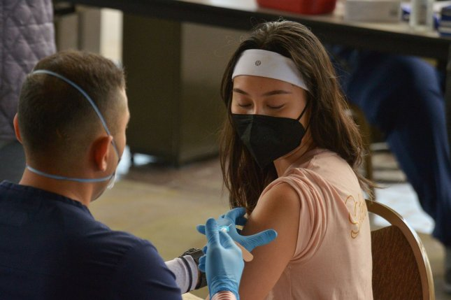 A health worker administers the Moderna COVID-19 vaccine to a local resident at the Long Beach Convention Center in Long Beach, California, on March 8. File photo by Jim Ruymen/UPI
