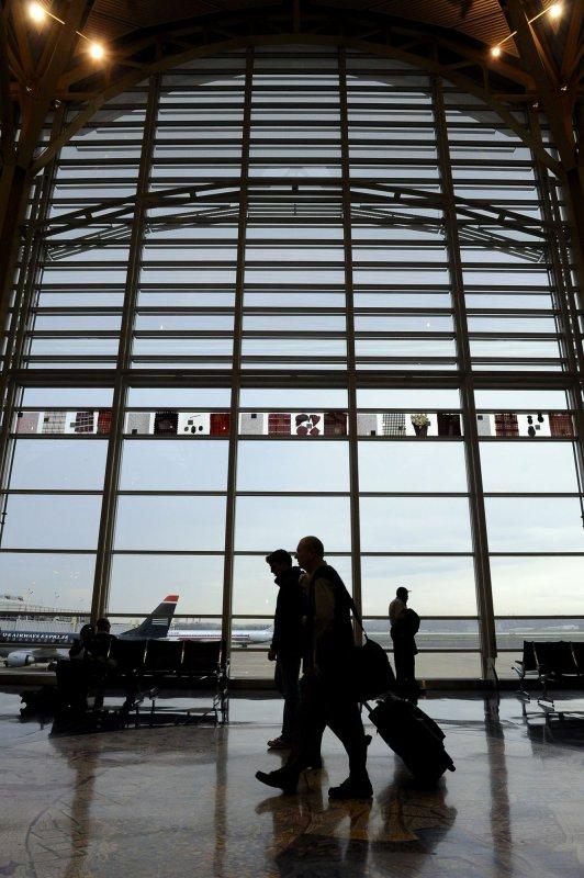 Passengers pass through Ronald Reagan Washington National Airport on November 23, 2010. File/UPI/Roger L. Wollenberg