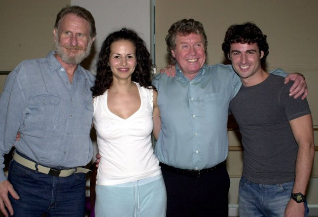NYP2002091901- NEW YORK, Sept. 19 (UPI) - Cast members Rene Auberjonois, Mandy Gonzalez, Michael Crawford and Max Von Essen (left to right) pose after a Sept. 18, 2002 press dress rehearsal for the upcoming Broadway musical Dance of the Vampires ep/Ezio Petersen UPI