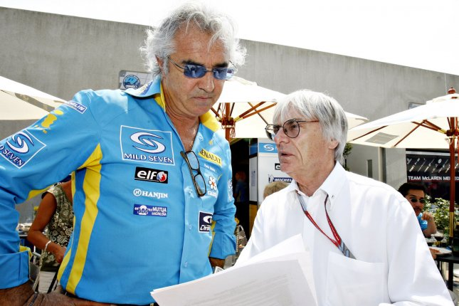Renault team Principal director Flavio Briatore, left talks with Formula One president Bernie Ecclestone before the start of the U.S. Grand Prix at Indianapolis in 2006. (UPI Photo/Tom Russo)