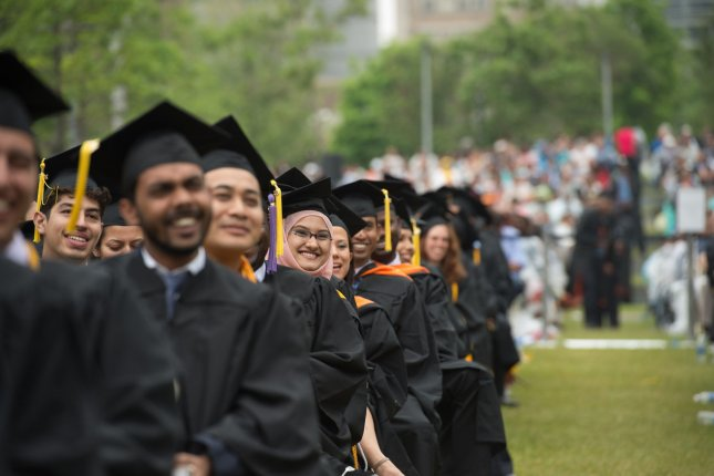 The 170th commencement ceremony of The City College of New York in Harlem on Friday, June 3, 2016. A study by led by a Stanford University professor of education shows young people who are most fluent in social media are the least adept at evaluating the quality and reliability of information they find there. Photo by Bryan R. Smith/UPI