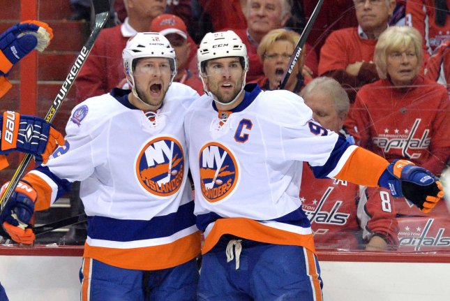 John Tavares (R) scored 34 seconds into overtime and the Islanders produced a solid bounce-back result by defeating the Carolina Hurricanes 3-2 at PNC Arena. File Photo by Kevin Dietsch/UPI