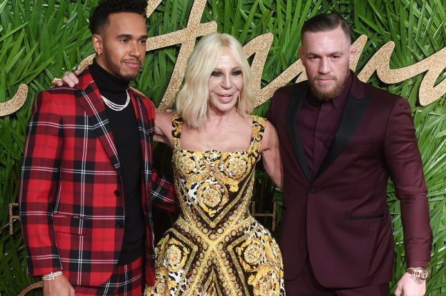 British racing driver Lewis Hamilton, Italian designer Donatella Versace and mixed martial artist Conor McGregor attend the Fashion Awards at Royal Albert Hall on Monday in London. Photo by Rune Hellestad/UPI