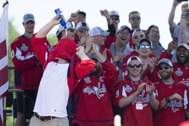 949b07fb1 Washington Capitals  T. J. Oshie pours beer on his head during their  victory parade Tuesday in Washington