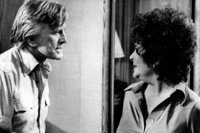 Kirk Douglas (L) and Elizabeth Taylor are pictured during the production the ABC television special Victory at Entebbe in Hollywood on November 15, 1976. UPI File Photo