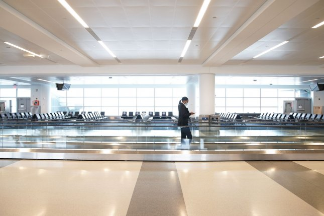 The gates at Terminal 4 of JFK International Airport are mostly empty of travelers and only a few shops are open for business in New York City on Tuesday. Photo by John Angelillo/UPI