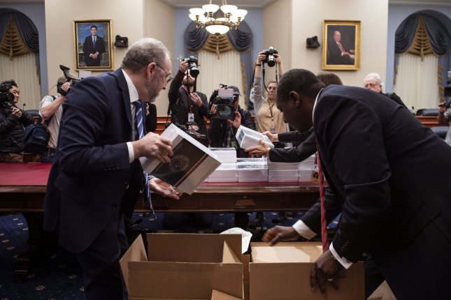 Members of the Government Printing Office upload copies of President Donald Trump's proposed FY2021 Budget on Capitol Hill on Feb. 10. The Federal Reserve said government debt increased by nearly 59% in the second quarter because of the coronavirus pandemic. Photo by Kevin Dietsch/UPI