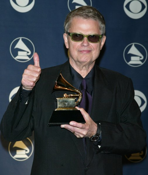 Charlie Haden shows off his Grammy for Best Latin Jazz Album at the 47th Grammy Awards in Los Angeles on February 13, 2005. (UPI Photo/Laura Cavanaugh)