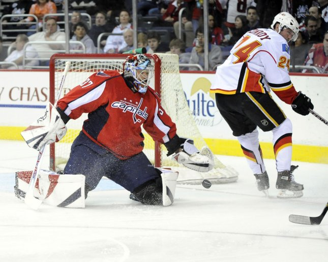 Olaf Kolzig (37), shown stopping a shot during a March 2008 game when he was with the Washington Capitals, on Wednesday announced his retirement, ending a 17-year NHL career. (UPI Photo/Mark Goldman)
