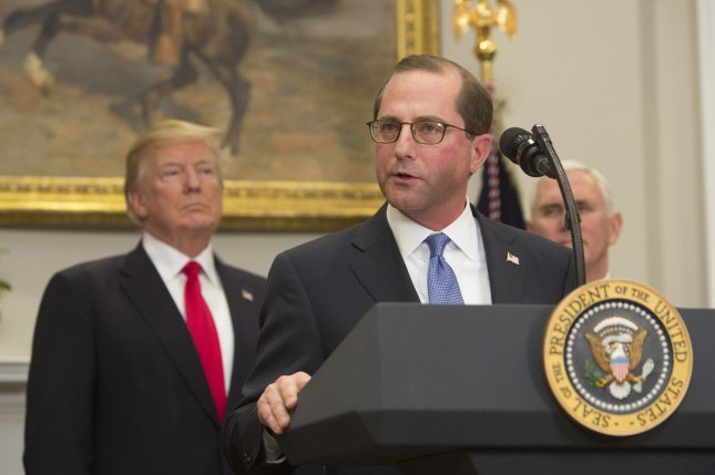Alex Azar, Health and Human Services Secretary, delivers remarks alongside President Donald Trump after being sworn-in during a ceremony in the Roosevelt Room at The White House on Monday. Photo by Chris Kleponis/UPI