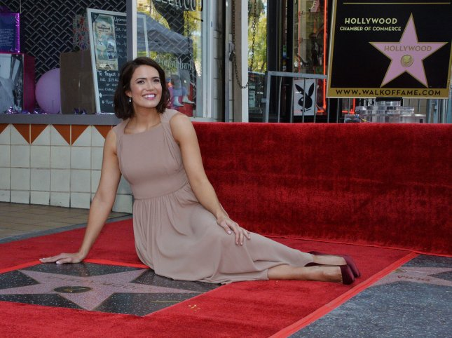 Actress and musician Mandy Moore sits beside her star during an unveiling ceremony honoring her with the 2,658th star on the Hollywood Walk of Fame in Los Angeles on Monday. Photo by Jim Ruymen/UPI