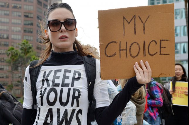 An abortion rights advocate attends a rally in Los Angeles on May 21. File Photo by Chris Chew/UPI