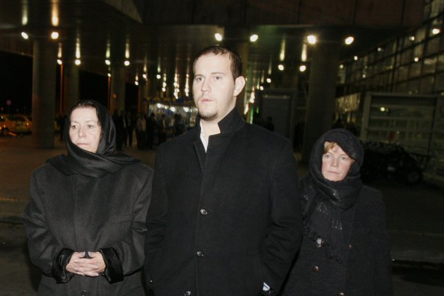 Christine Levinson, wife of an ex-FBI agent Robert Levinson, who disappeared in Iran in March 2007, her son Daniel and her sister Susan arrive at Imam Khomeini International Airport in Tehran on December 18, 2007. Levinson's family on Wednesday said he has died. UPI File Photo