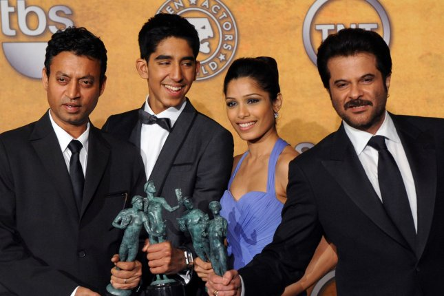Left to right, Slumdog Millionaire stars Irrfan Khan, Dev Patel, Freida Pinto and Anil Kapoor were honored at the 2009 SAG Awards. Khan died Wednesday at age 53. File Photo by Jim Ruymen/UPI