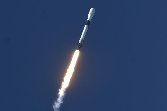 A SpaceX Falcon 9 rocket lifts off from Cape Canaveral Air Force Station in Monday, carrying the Anasis 2 a communications satellite for the South Korean military. Photo by Joe Marino/UPI