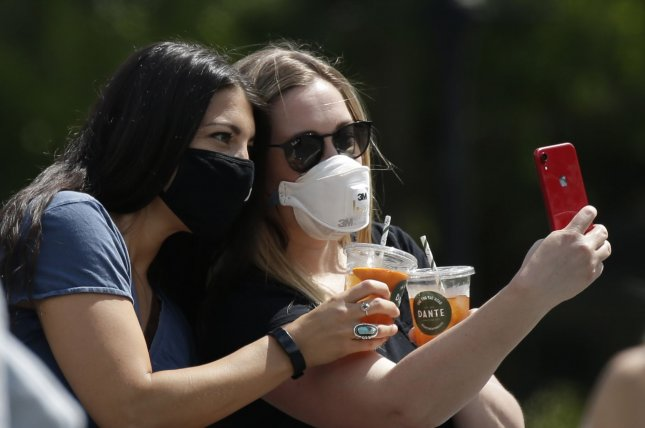 A new study suggests there were far more COVID-19 cases in the United States this spring than the official counts show. Pictured, two women wear protective face masks in Washington Square Park during Memorial Day weekend in New York City in May. Photo by John Angelillo/UPI